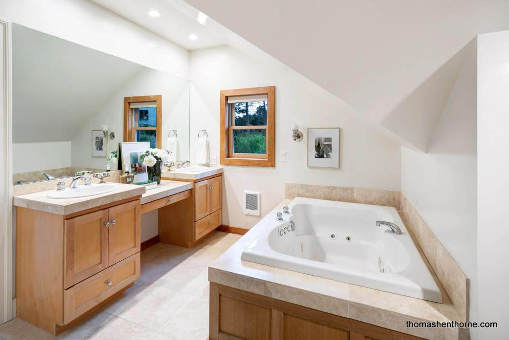 Bathroom with dual sinks and jetted tub