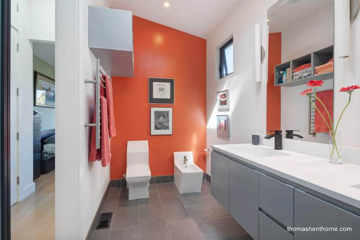 Modern bathroom with orange wall