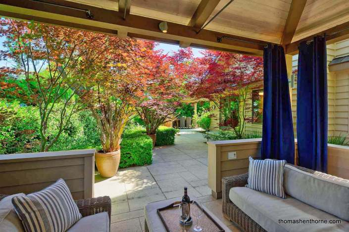 Outdoor living room with curtains