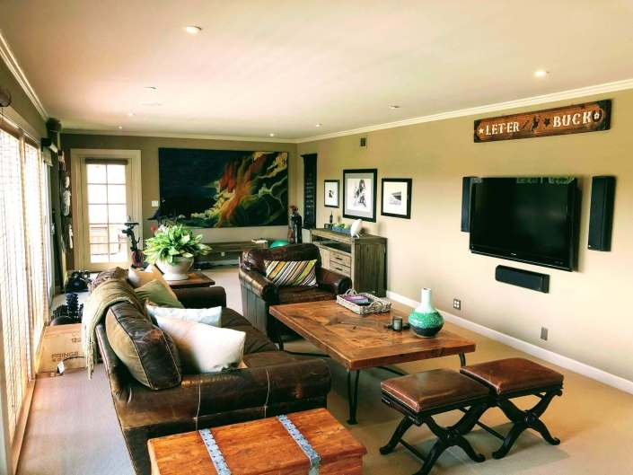 Family room with leather sofa and TV on wall
