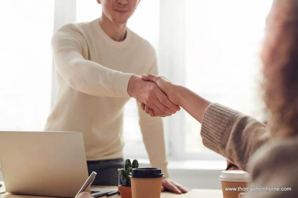 Handshake a successful deal after a low offer on a home