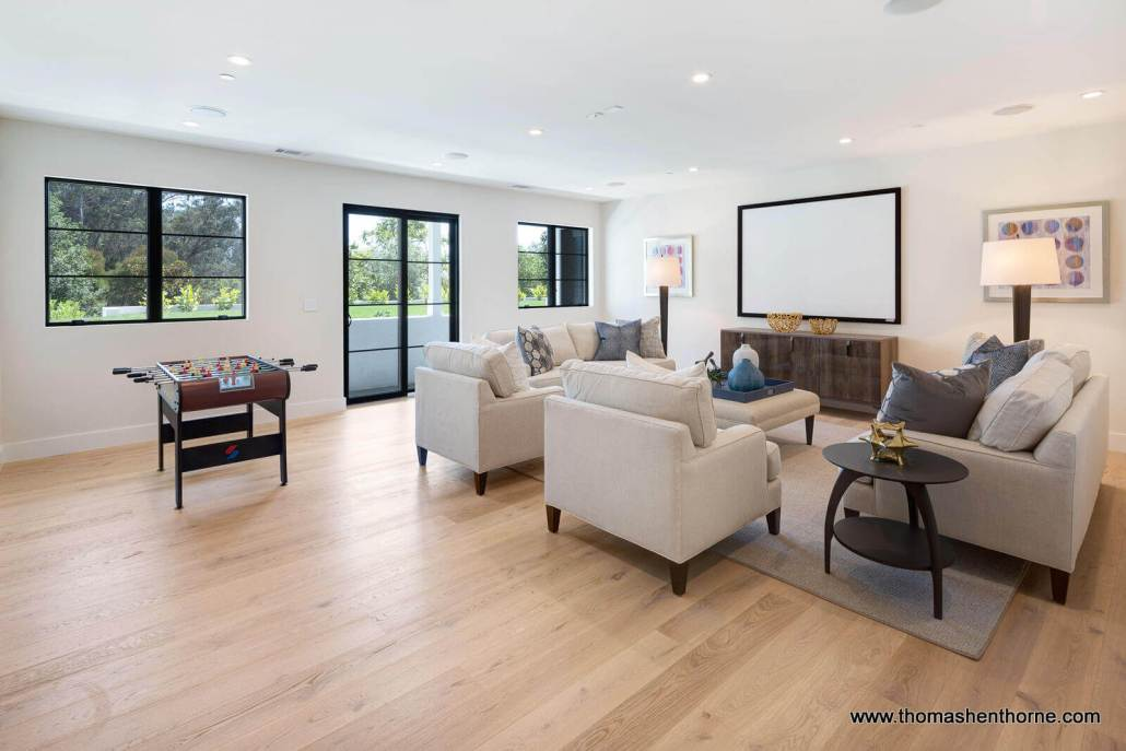 home media room with wood floors