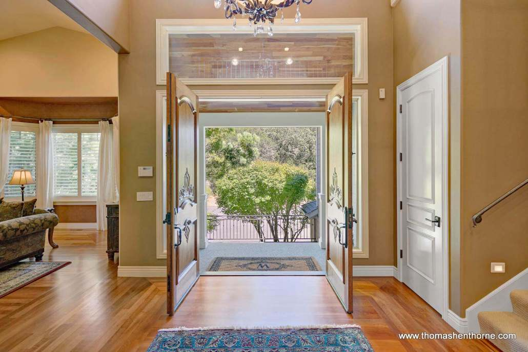 Entry foyer from inside home with two double doors