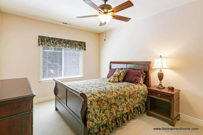 Sleigh bed and ceiling fan