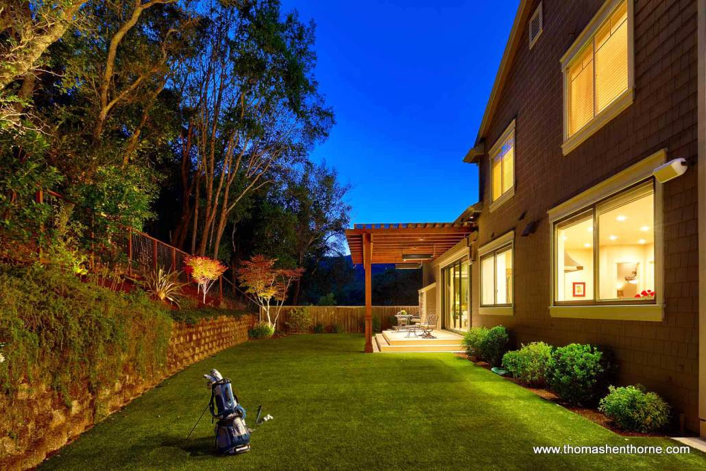Back yard at dusk with golf bag on grass