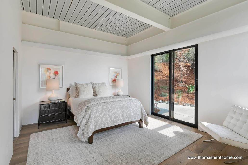 bedroom with sliding doors outside