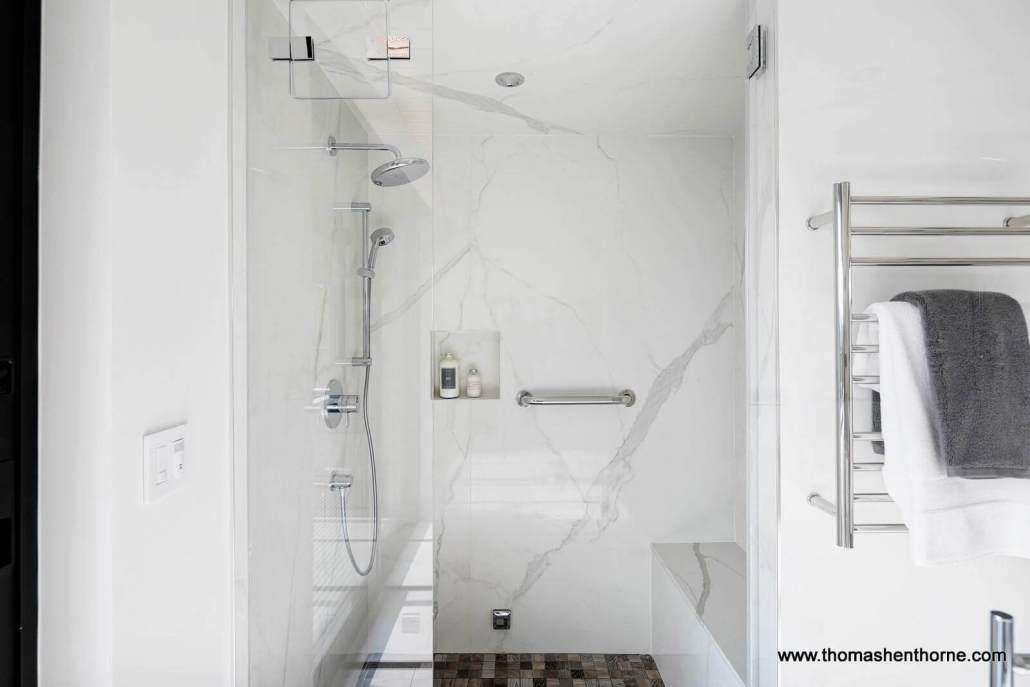 luxury home bathroom with marble walls