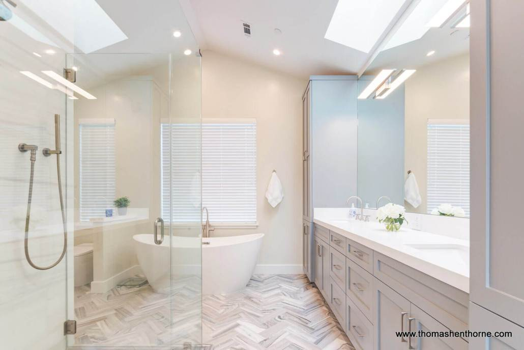 master bathroom with dual sinks and tile floor