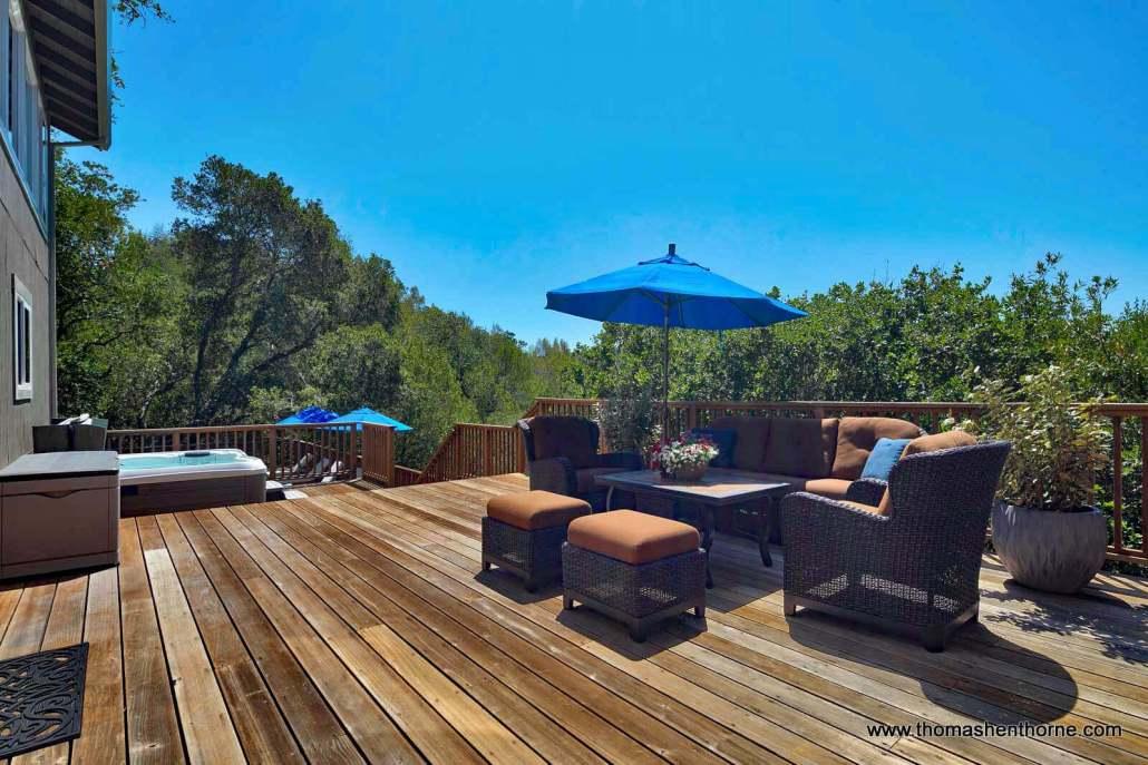 outdoor sofa with blue umbrella