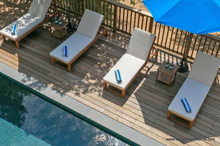 swimming pool with chaise lounges