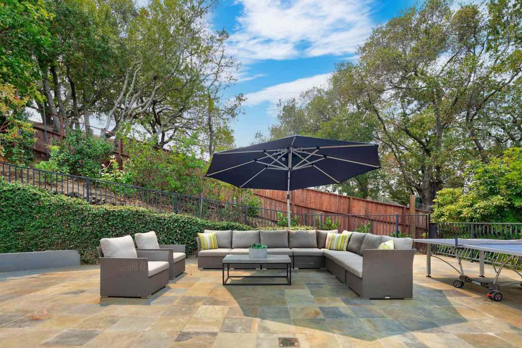 Seating area with umbrella and two chairs