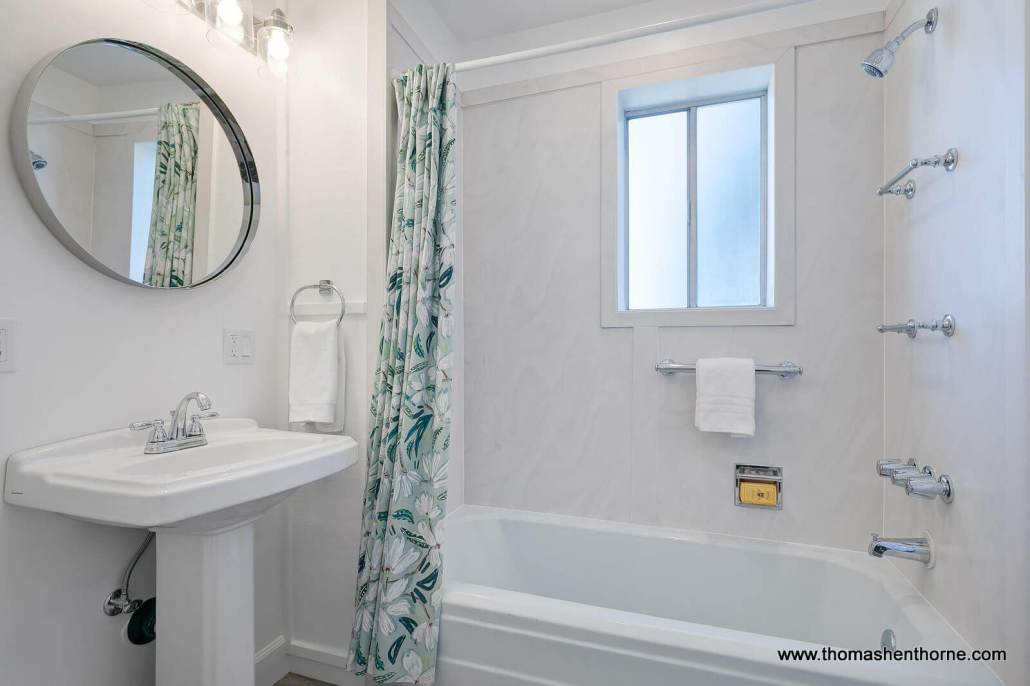 bathroom with tub shower combo