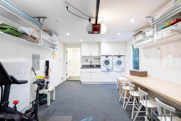 garage with laundry and craft table