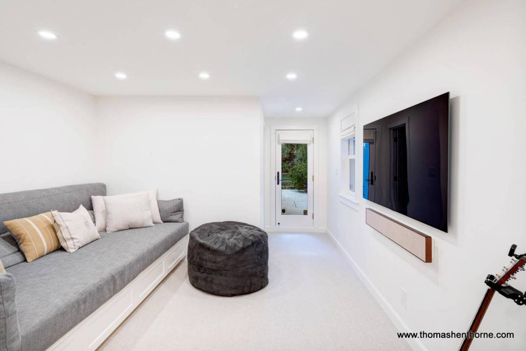 room with daybed and tv mounted on wall