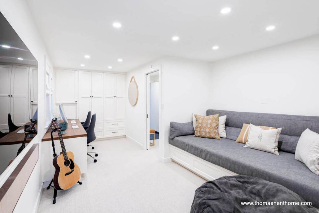 room with guitar and daybed