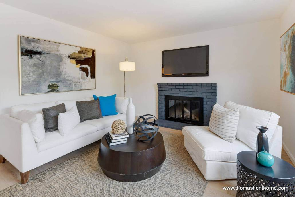 sofa and chair with fireplace