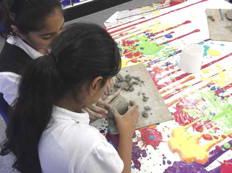 Our Y6/5 class have been working cooperatively to make clay igloos.