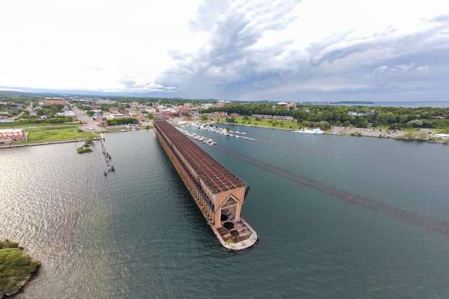 An Aerial Shot of the Abandoned and Iconic Ore Dock in Marquette, Michigan Along the Shore of Lake Superior
