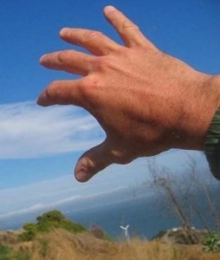 Hand Reaching Toward Clouds