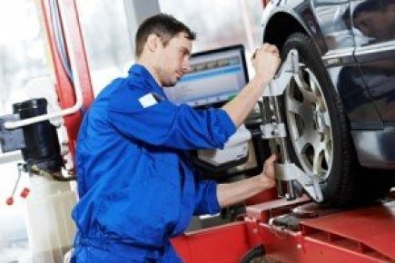 Mechanic Performing Wheel Alignment