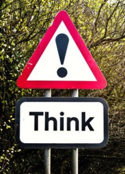 Danger Road Sign with the Word Think on it