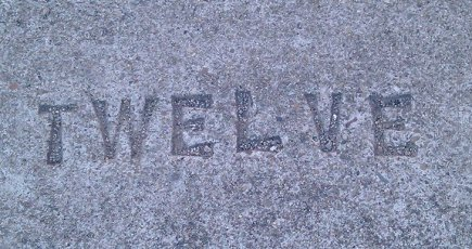 Word Twelve Stamped in Concrete