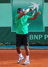 Tennis Player Returning a Serve