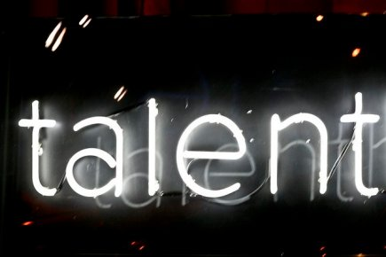 The Word Talent Written in White Neon