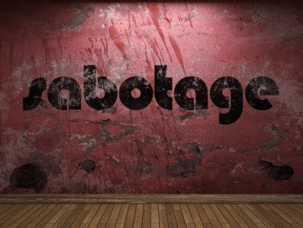 Word Sabotage on a Red Wall