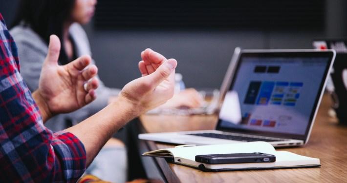 meeting hands gesturing