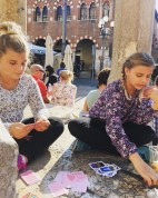Kids playing cards in Verona