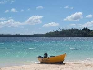 Small boat on sandy beach Vavau Tonga