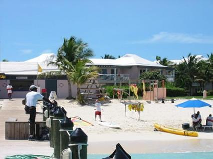 The watersports center (SCUBA, snorkel, boats etc.), with in the background Parrot Cay villas