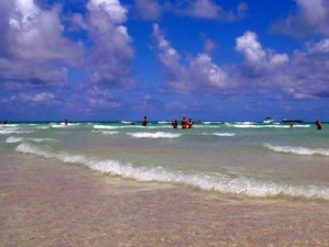 Wading in the surf at Miami Beach, Florida