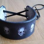 black leather cuff with white scull