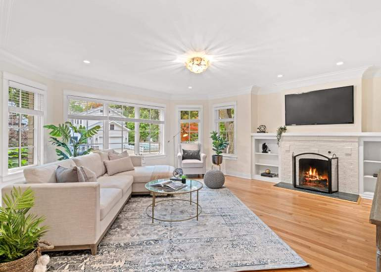 Professional real estate photo of the house for sale, spacious living room with a fireplace