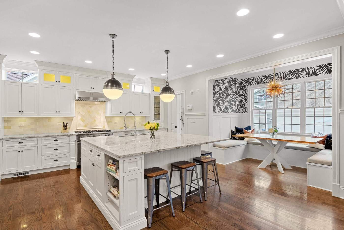 Professional real estate photo of the modern and spacious kitchen with a seating area in the house for sale in Chicago