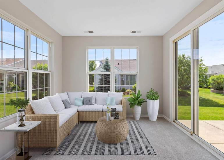 Virtual staging services for real estate photography - digital furniture in a sunroom