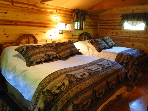 Luxury bedding with western antiques in each cabin