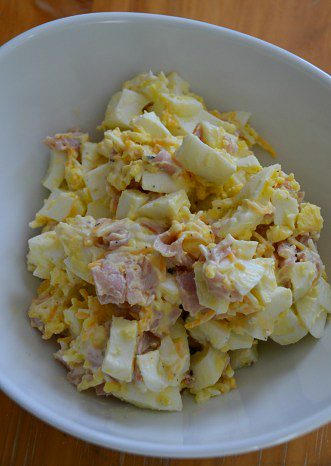 hardboiled egg with mayonaise cheese and ham