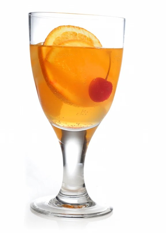 non-alcoholic cocktail with orange and cherry