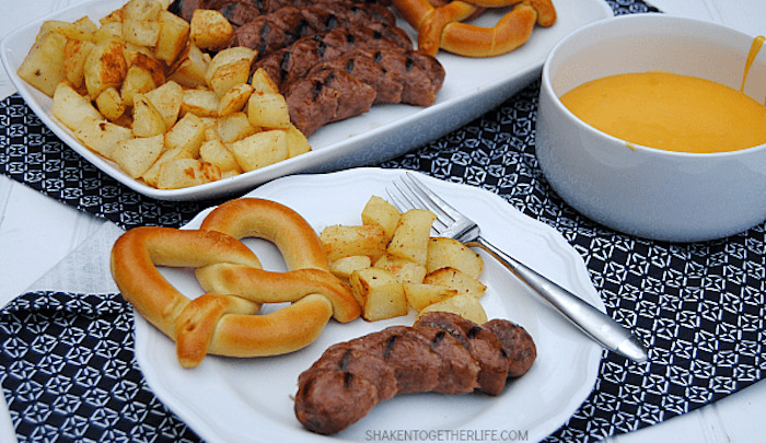 bratwurst dippers and cheese sauce with pretzel