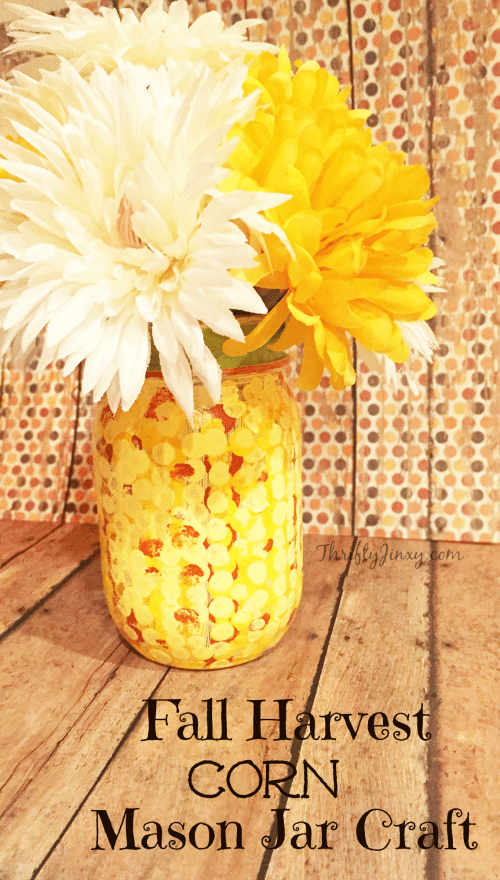 This DIY Fall Harvest Corn Mason Jar Craft is perfect to display an autumn bouquet, pens and pencils, or even your kitchen utensils!