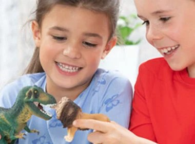 Children Playing with Schleich Dinosaur and Lion