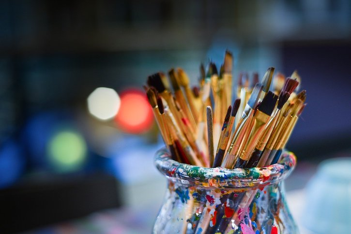 Paint Brushes in Jar Covered with Paint