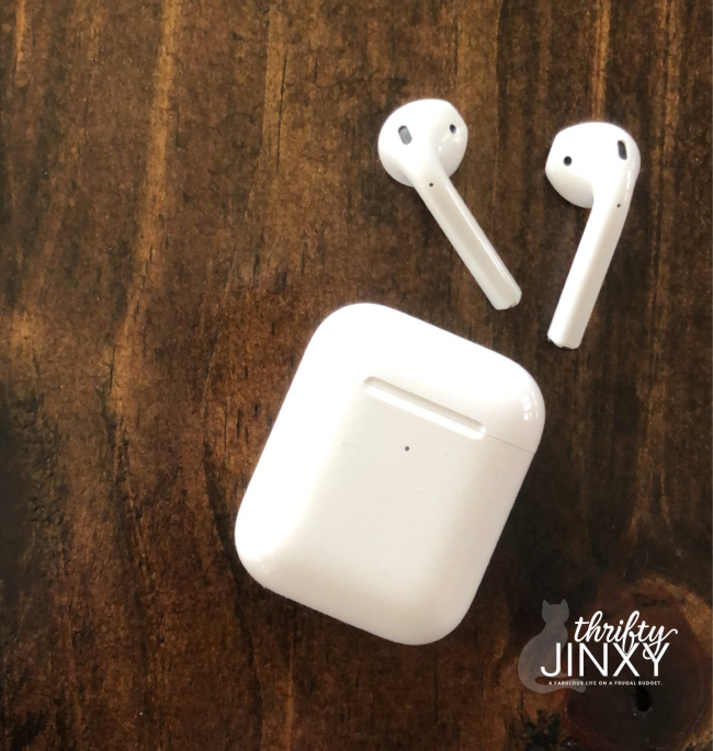 apple airpods on wood background