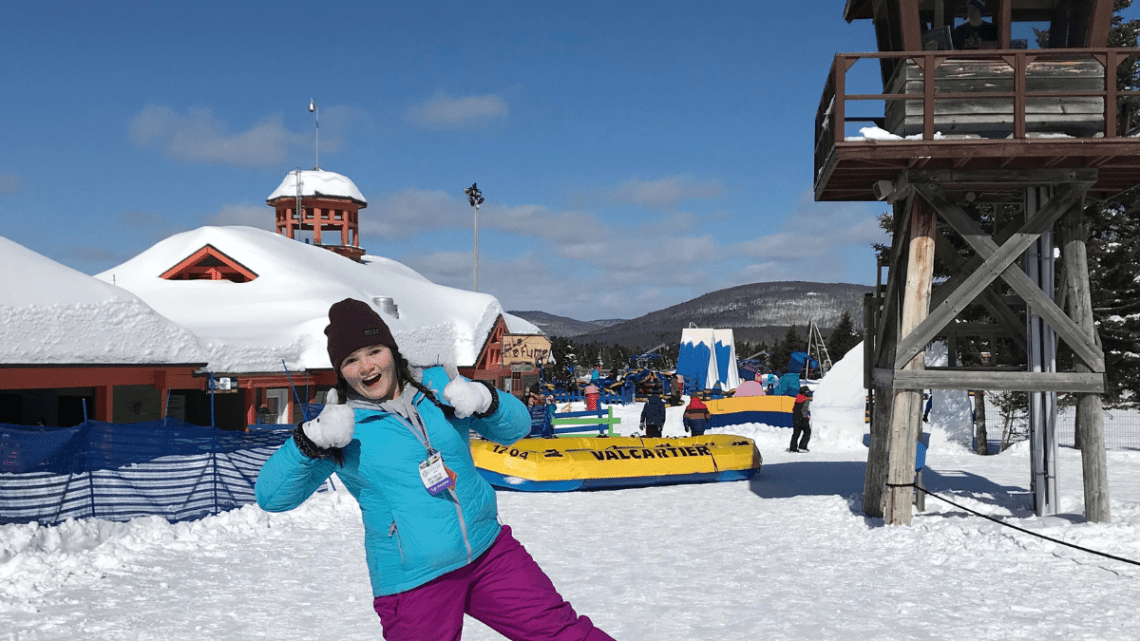 child_celebrating_valcartier_raft_ride_in_snow