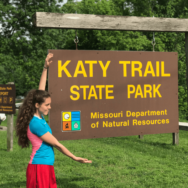 katy_trail_state_park_sign_columbia_missouri_girl_standing_beside