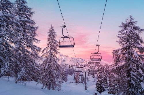 ski_in_ski_out_resorts_chairlift_pink_sky_snow