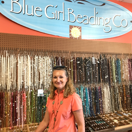 blue_girl_beading_wall_of_beads